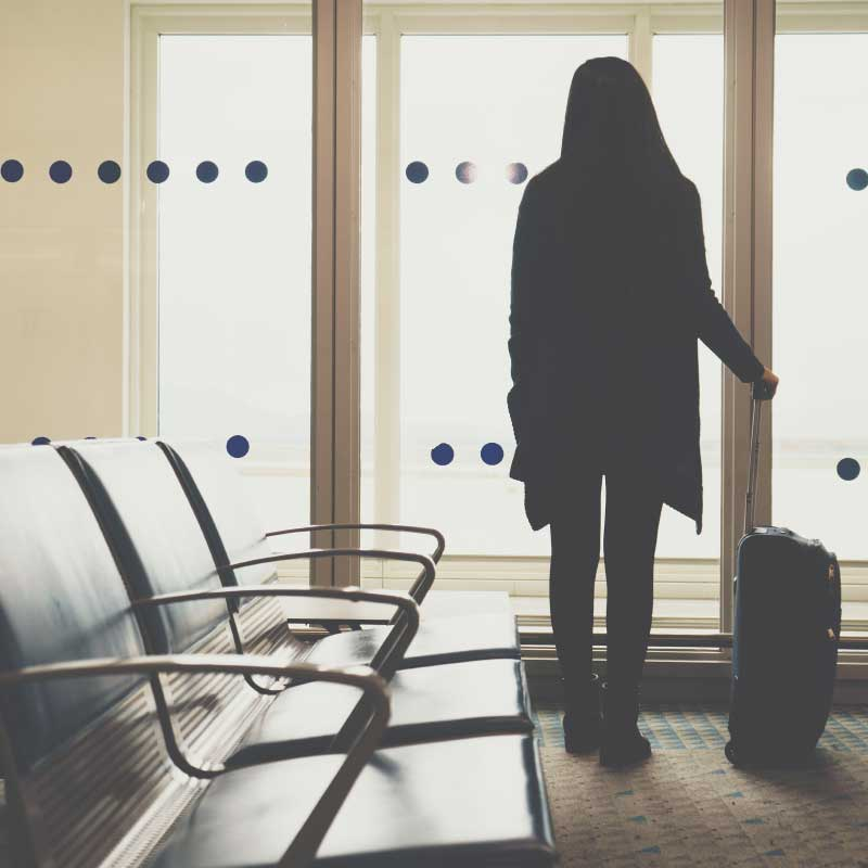 young-woman-in-the-airport-looking-through-the